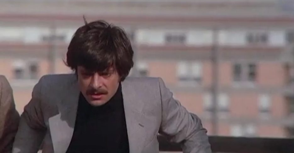 A screenshot taken from The Black Belly of the Tarantula. It shows a man, inspector Tellini, who looks deeply shocked.